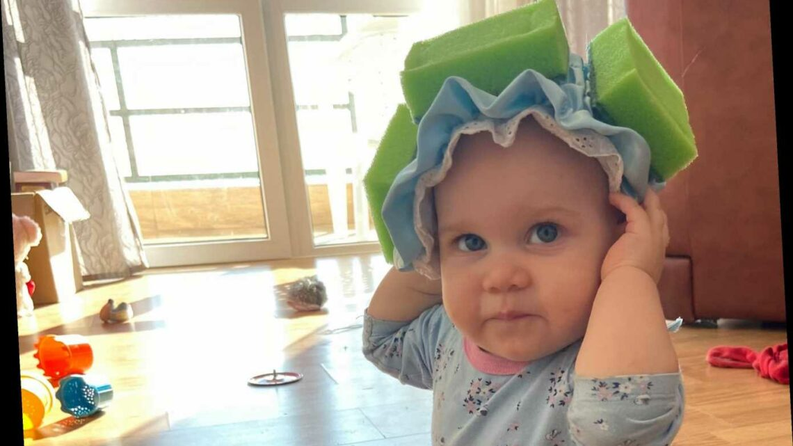 Mum puts SPONGES on shower caps to protect her toddler's head while learning to walk in genius parenting hack