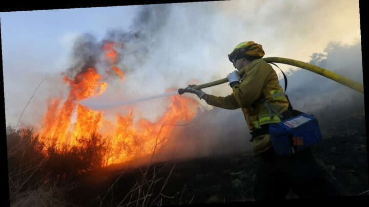 Southern California wildfire fanned by hot, dry and windy weather