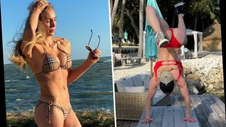 WWE star Charlotte Flair shares sexy beach yoga pose while wearing a red bikini in latest Instagram clip