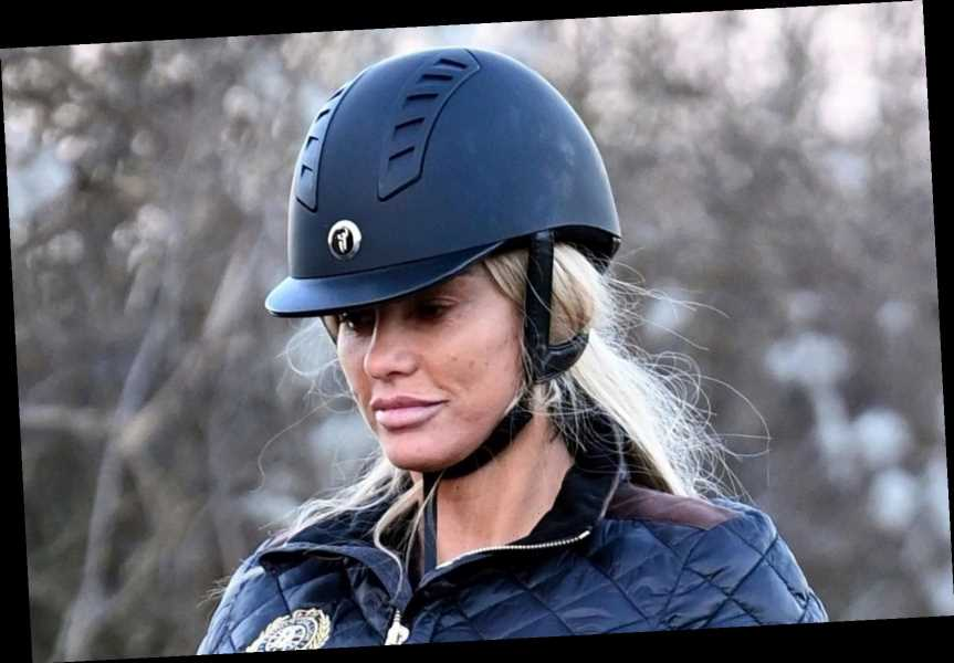 Katie Price gets back on her horse as boyfriend Carl Woods follows on a bike in the countryside