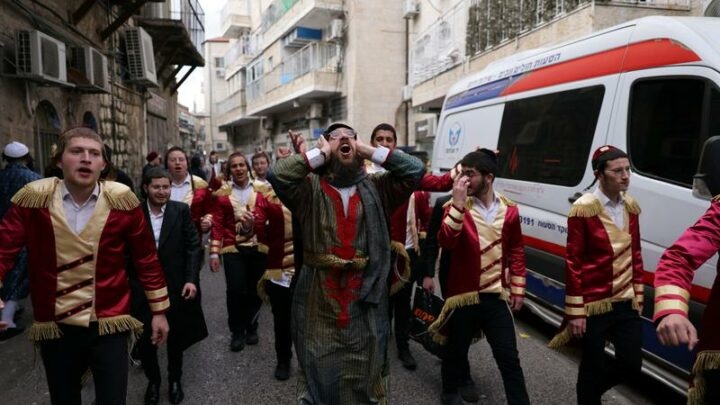 COVID curbs dampen carousing on Jewish costume festival Purim