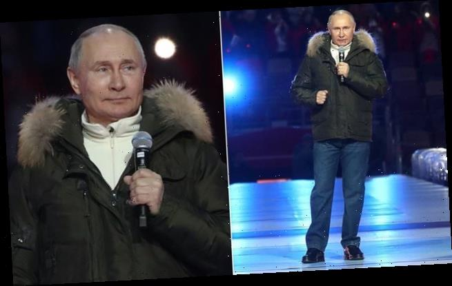 Putin appears at concert marking anniversary of Crimea's annexation