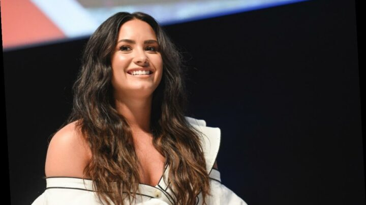 Demi Lovato's Birth Chart Speaks To Her Unwavering Strength & Courage