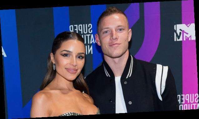Olivia Culpo Hits The Pool In A Bikini & Makes Out With BF Christian McCaffrey In New Photos