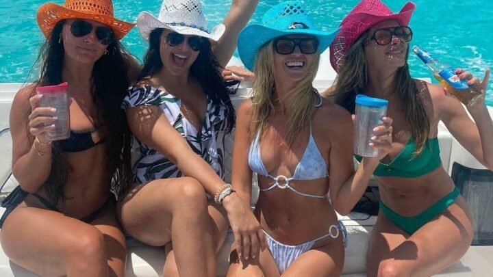 Brooks Koepka's fiancee Jena Sims looks sensational in tiny green bikini while partying with pals on Bahamas break