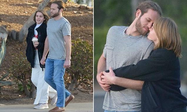 Emma Watson cuddles up to rumoured fiancé Leo Robinton during stroll