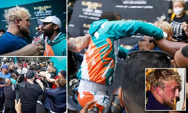 Floyd Mayweather and Jake Paul throw punches during WILD press call