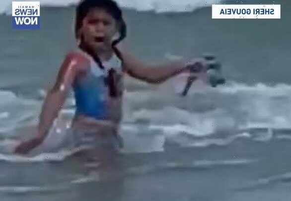 Girl, 6, flees in terror as shark prowls just inches behind her