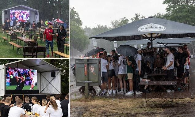 Devastated German fans are soaked as thunderstorms break out