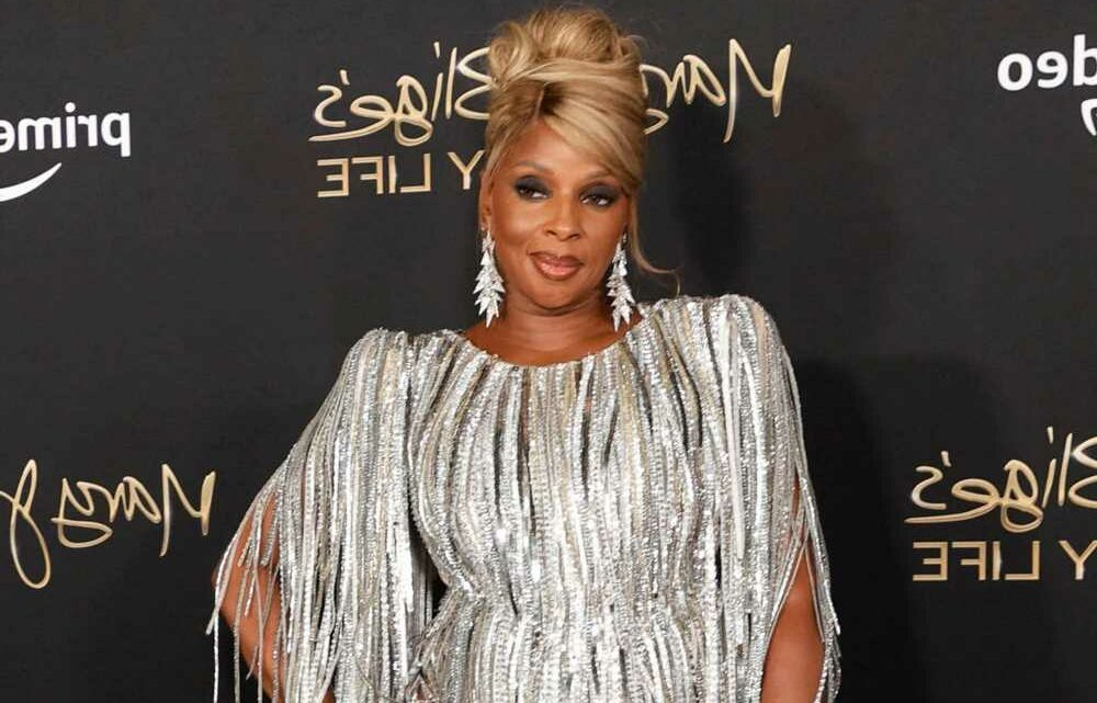 Mary J. Blige, 50, dazzles in slit-up-to-there silver fringe