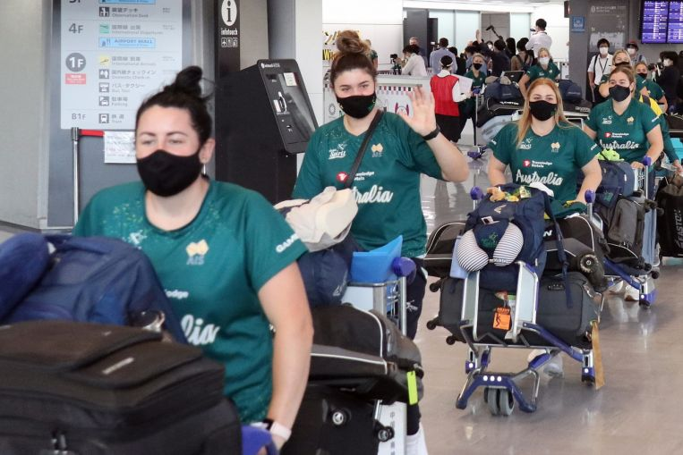 Olympics: Australia's softball squad arrives in Tokyo as Japan widens vaccine roll-out