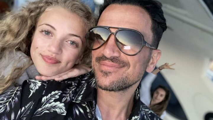 Peter Andre poses on a yacht with his daughter Princess as his wife Emily photobombs them