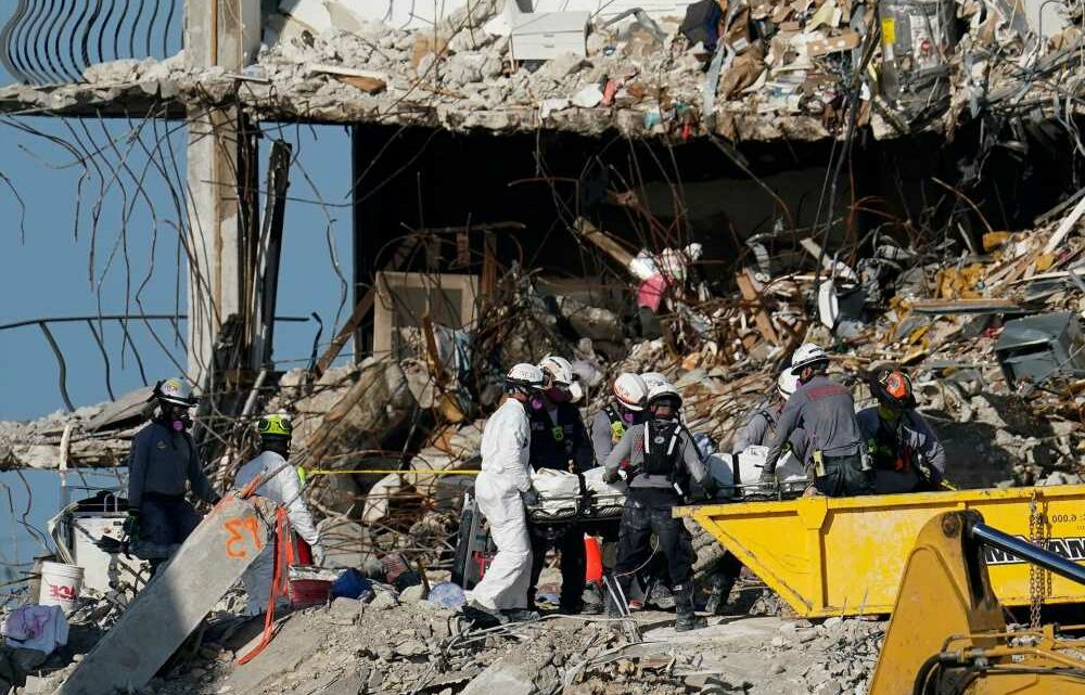 Grieving firefighter recovers his own child's body from rubble of Florida condo collapse