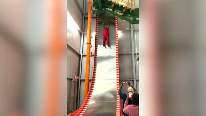 Man screams, refuses to go down slide in hilarious video