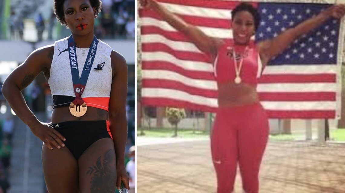 Olympian Gwen Berry accused of hypocrisy as pic of her posing with US flag goes viral after National Anthem protest fury