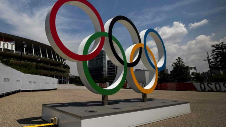 Olympic chief confirms Games could STILL be called off at the last-minute as Tokyo faces a TRIPLE health threat