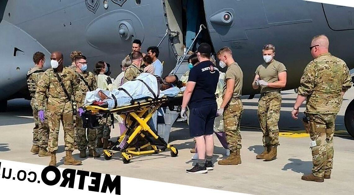 Afghan woman gives birth on US military plane after fleeing Kabul