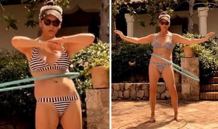 Catherine Zeta-Jones showcases incredible figure in stripe bikini for hula hooping video