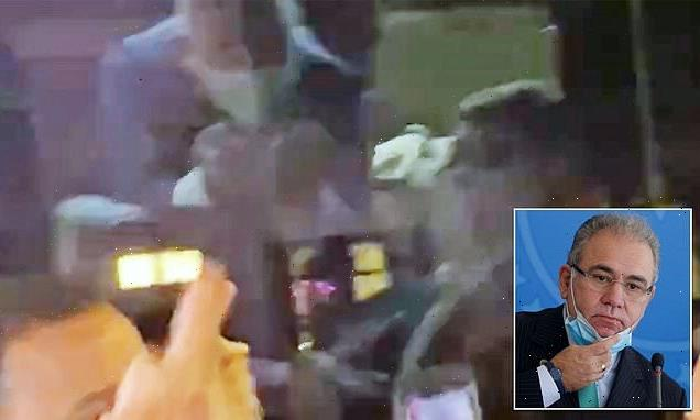 Brazil's COVID-19 positive health minister flips off protesters