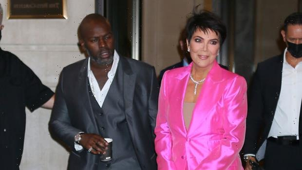 Kris Jenner Turns Heads In Pink Suit As She & Corey Gamble Head To Paris Hilton's Engagement Party