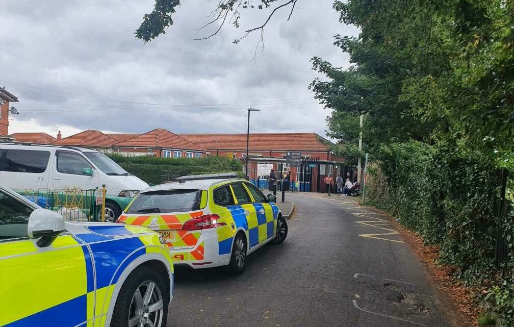 Workman suffers serious injuries after getting trapped in machinery at school as ambulance crews rush him to hospital