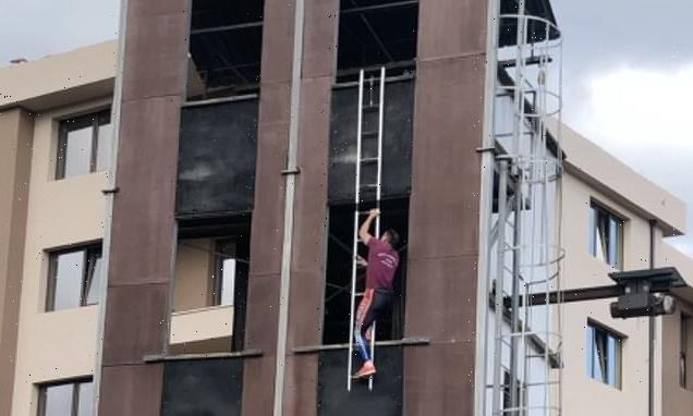Bulgarian athlete scales four-storey tower with ladder in 14 SECONDS