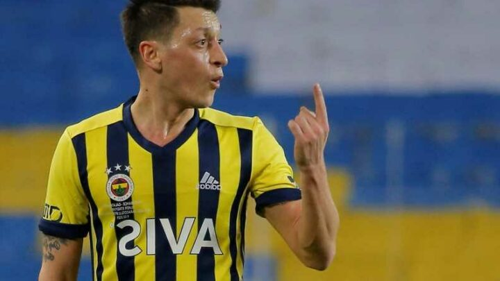 Fuming Mesut Ozil kicks water bottles and throws off shirt after ex-Arsenal star is subbed in Fenerbahce draw