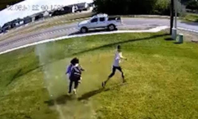 Homeowner sets up sprinklers to soak people walking across his lawn