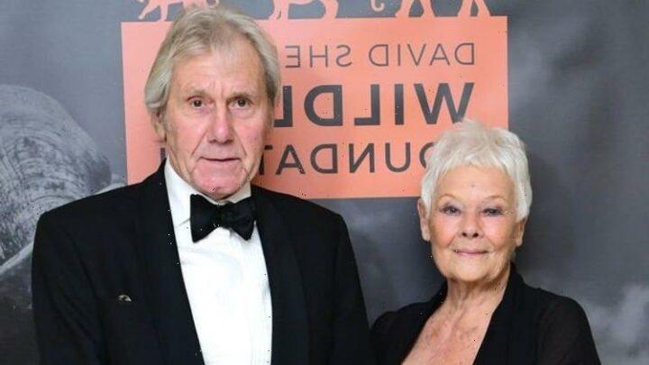 Judi Dench all smiles as partner honoured for conservation work