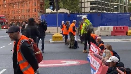 Traffic chaos as Insulate Britain eco-warriors block Old Street roundabout in London and furious drivers honk horns
